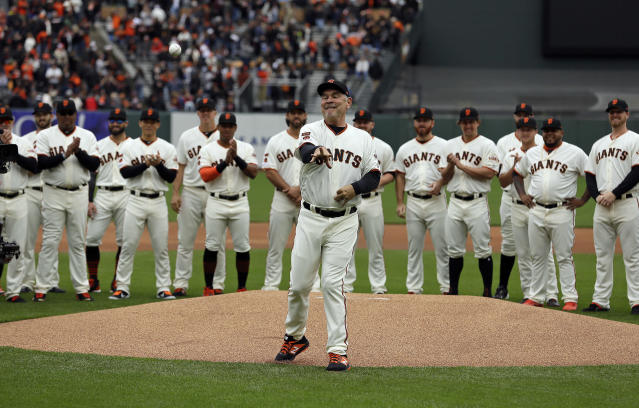 San Francisco Giants manager Bruce Bochy throws out the ceremonial first pitch before an opening day baseball game against the Tampa Bay Rays, Friday, April 5, 2019, in San Francisco. Bochy, who is retiring at the end of the season, was honored in pregame ceremonies. (AP Photo/Eric Risberg)