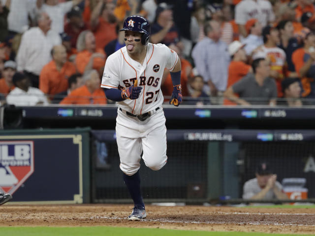 Jose Altuvejoined Babe Ruth, Reggie Jackson, George Brett, Albert Pujols and a handful of others as the only players to hit three home runs in a postseason game. (AP)