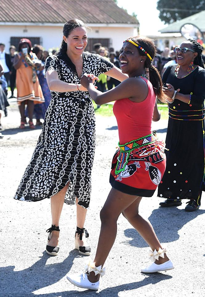 """Meghan Markle and Prince Harry even <a href=""""https://people.com/royals/meghan-markle-prince-harry-dance-first-tour-stop-south-africa/"""">showed off their dance moves</a> during their visit. """"Their dance moves are great. They've got their African moves,"""" Nosisana Nama, 57, says. """"They were really enjoyed coming here and sharing this day with us."""""""