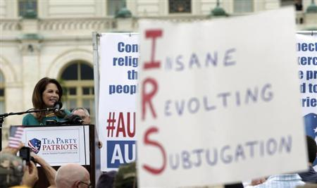 """Michele Bachmann addresses the crowd during a Tea Party rally to """"Audit the IRS"""" in front of the U.S. Capitol in Washington"""