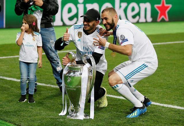 Soccer Football - Champions League Final - Real Madrid v Liverpool - NSC Olympic Stadium, Kiev, Ukraine - May 26, 2018 Real Madrid's Karim Benzema celebrates with the trophy after winning the Champions League REUTERS/Gleb Garanich