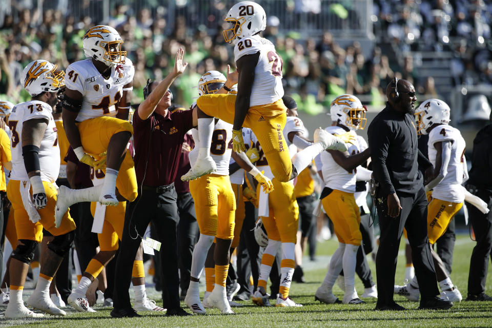 EAST LANSING, MI - SEPTEMBER 14: Khaylan Kearse-Thomas #20 and Tyler Johnson #41 of the Arizona State Sun Devils celebrate after a missed field goal by the Michigan State Spartans in the first half of the game at Spartan Stadium on September 14, 2019 in East Lansing, Michigan. (Photo by Joe Robbins/Getty Images)