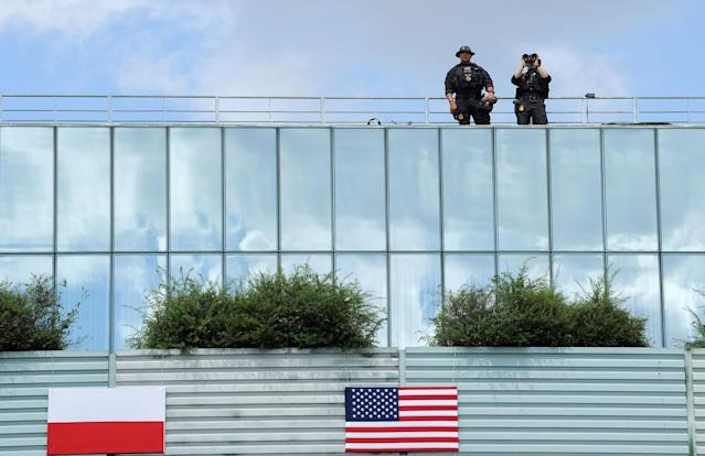 <p>Members of the Polish security forces use binoculars prior to U.S. President Donald Trump's speech in Krasinski Square, in Warsaw, Poland, Thursday, July 6, 2017.(Photo: Alik Keplicz/AP) </p>