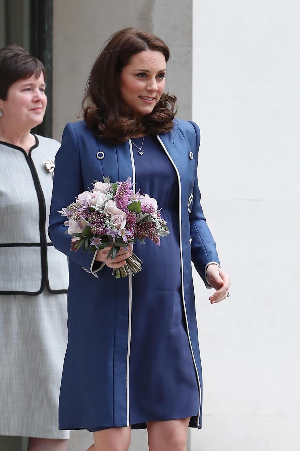 The Duchess of Cambridge looked effortlessly stylish in a Jenny Packham collar-less coat [Photo: Getty]