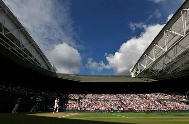LONDON, ENGLAND - JULY 06: Andy Murray of Great Britain hits a forehand shot during his Gentlemen's Singles semi final match against Jo-Wilfried Tsonga of France on day eleven of the Wimbledon Lawn Tennis Championships at the All England Lawn Tennis and Croquet Club on July 6, 2012 in London, England. (Photo by Paul Gilham/Getty Images)