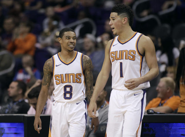 "<a class=""link rapid-noclick-resp"" href=""/nba/teams/pho"" data-ylk=""slk:Phoenix Suns"">Phoenix Suns</a>' <a class=""link rapid-noclick-resp"" href=""/nba/players/5665/"" data-ylk=""slk:Tyler Ulis"">Tyler Ulis</a> and <a class=""link rapid-noclick-resp"" href=""/nba/players/5473/"" data-ylk=""slk:Devin Booker"">Devin Booker</a> were involved in a fight in an elevator last year, according to a report from TMZ Sports. (AP Photo/Ralph Freso)"