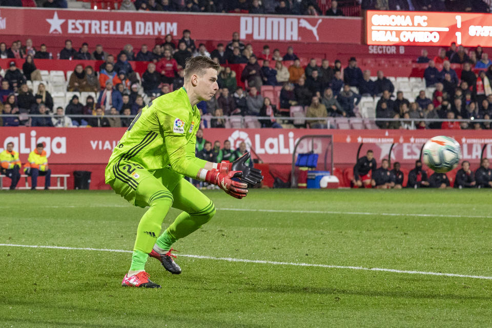GIRONA, SPAIN -January 26:   Goalkeeper Andriy Lunin #25 of Oviedo makes a save during the Girona V Real Oviedo, La Liga second division regular season match at Municipal de Montilivi on January 26th 2020 in Girona, Spain. (Photo by Tim Clayton/Corbis via Getty Images)