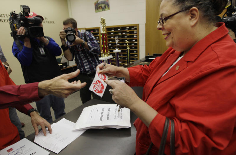 Chicago Teachers Union President Karen Lewis gets a sticker after casting her ballot during a strike authorization vote at a Chicago high school Wednesday, June 6, 2012. Lewis says union members don't want to disrupt the start of the next school year with a strike, but she says they feel voting to authorize one is needed to negotiate a better contract. (AP Photo/M. Spencer Green)