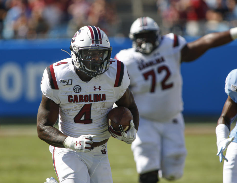 South Carolina running back Tavien Feaster rushes for a touchdown in the first half against North Carolina in the first half of an NCAA college football game in Charlotte, N.C., Saturday, Aug. 31, 2019. (AP Photo/Nell Redmond)