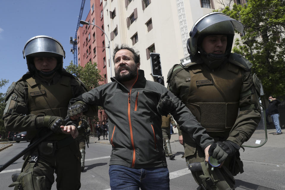 Police detain a demonstrator in Santiago, Chile, Sunday, Oct. 20, 2019. Protests in the country have spilled over into a new day, even after President Sebastian Pinera cancelled the subway fare hike that prompted massive and violent demonstrations. (Photo: Esteban Felix/AP)