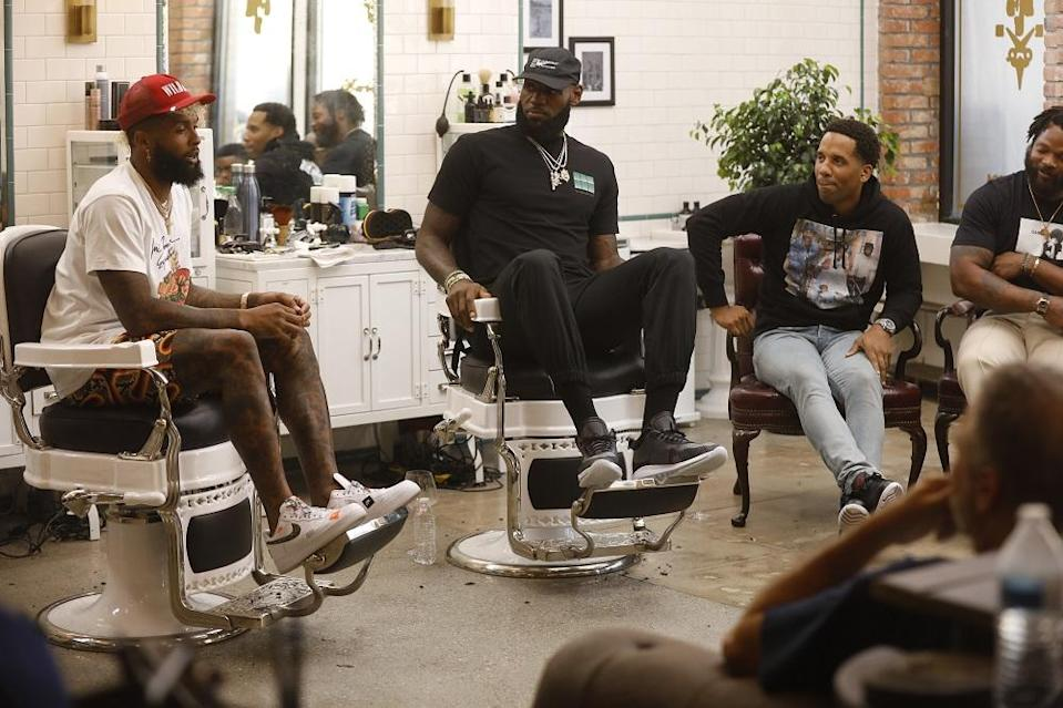 """NFL star Odell Beckham Jr. (L) speaks while LeBron James, Maverick Carter (R) and others listen during the first episode of HBO's """"The Shop."""" (Image courtesy of HBO)"""