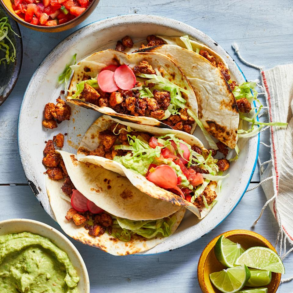 "<p>Take taco night in a new direction with these healthy vegan tacos. We've swapped crumbled tofu for the ground beef, without sacrificing any of the savory seasonings you expect in a taco. You can also use the filling in burritos, bowls, taco salads and to top nachos. <a href=""http://www.eatingwell.com/recipe/272203/beefless-vegan-tacos/"" rel=""nofollow noopener"" target=""_blank"" data-ylk=""slk:View recipe"" class=""link rapid-noclick-resp""> View recipe </a></p>"