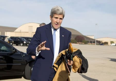 U.S. Secretary of State John Kerry is seen before boarding his plane at Andrews Air Force Base in Maryland, en route to Ottawa, Canada, October 28, 2014. REUTERS/Carolyn Kaster/Pool