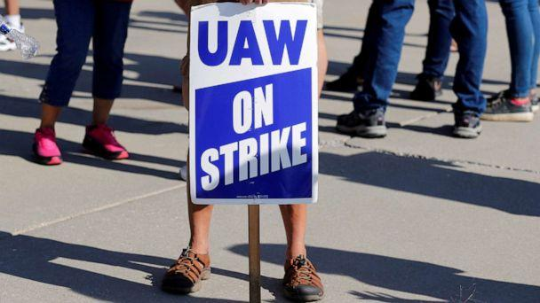 PHOTO: A striking worker holds a sign outside the shuttered General Motors Lordstown Assembly plant during the United Auto Workers national strike in Lordstown, Ohio, Sept. 20, 2019. (Rebecca Cook/Reuters, FILE)