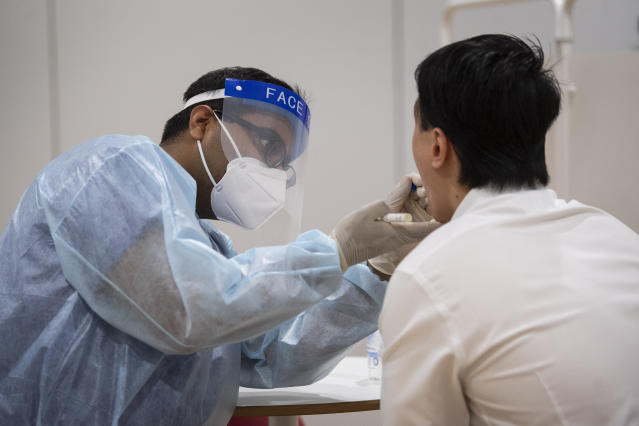 A member of staff at Legal and General is tested for coronavirus ahead of returning to the company's head office in London. (Getty)