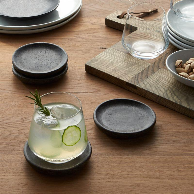 """<p><strong>Crate and Barrel</strong></p><p>crateandbarrel.com</p><p><strong>$9.95</strong></p><p><a href=""""https://go.redirectingat.com?id=74968X1596630&url=https%3A%2F%2Fwww.crateandbarrel.com%2Fset-of-4-cole-coasters%2Fs548367&sref=https%3A%2F%2Fwww.cosmopolitan.com%2Fstyle-beauty%2Ffashion%2Fg32619153%2Fgifts-for-man-who-has-everything%2F"""" rel=""""nofollow noopener"""" target=""""_blank"""" data-ylk=""""slk:Shop Now"""" class=""""link rapid-noclick-resp"""">Shop Now</a></p><p>Some guys are notorious for leaving drink rings on the wood furniture. But he'll love these clay coasters so much, he'll actually want to use them for once.</p>"""