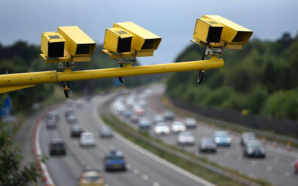 Speed cameras overlooking a motorway in Bedfordshire - PA