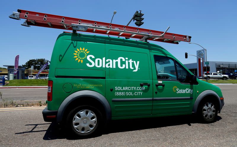 FILE PHOTO: A SolarCity vehicle is seen on the road in San Diego, California