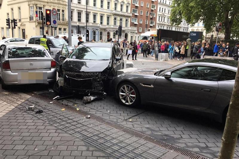 Damage to the front of a black car at the scene of the crash in South Kensington (Stefano Sutter)