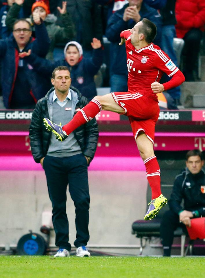 Bayern Munich's Franck Ribery celebrates after scoring goal as FC Augsburg's coach Markus Weinzierl (L) watches during their German first division Bundesliga soccer match in Munich November 9, 2013. REUTERS/Michael Dalder (GERMANY - Tags: SPORT SOCCER) DFL RULES TO LIMIT THE ONLINE USAGE DURING MATCH TIME TO 15 PICTURES PER GAME. IMAGE SEQUENCES TO SIMULATE VIDEO IS NOT ALLOWED AT ANY TIME. FOR FURTHER QUERIES PLEASE CONTACT DFL DIRECTLY AT + 49 69 650050