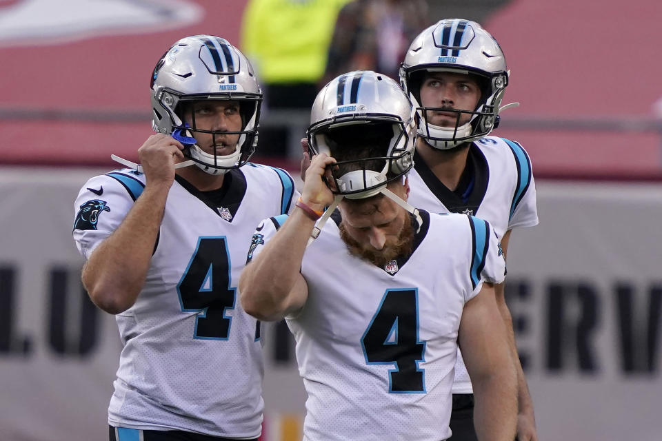 Carolina Panthers kicker Joey Slye, foreground, reacts after missing a field goal at the end of the second half of an NFL football game against the Kansas City Chiefs in Kansas City, Mo., Sunday, Nov. 8, 2020. (AP Photo/Jeff Roberson)