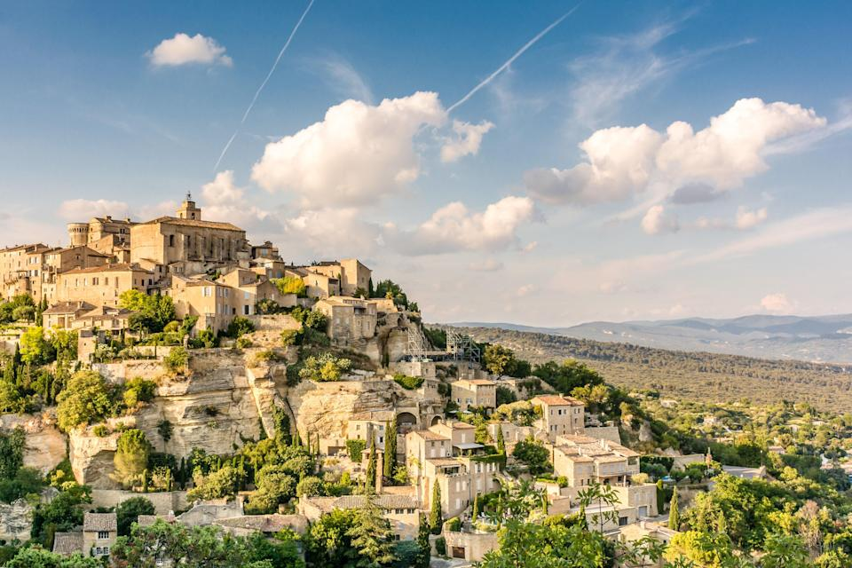 """<p><strong>Population:</strong> 1,974</p> <p>Yet another hilltop stunner, Gordes is easily one of the most charming towns in all of France. The elevated location makes it one of the best places in Provence to watch the sunset, and it also happens to be an excellent home base for <a href=""""https://www.cntraveler.com/gallery/where-to-see-blooming-flowers-around-the-world?mbid=synd_yahoo_rss"""" rel=""""nofollow noopener"""" target=""""_blank"""" data-ylk=""""slk:seeking out lavender fields"""" class=""""link rapid-noclick-resp"""">seeking out lavender fields</a> during the summer months. It's only a 10-minute drive from the town center to Sénanque Abbey, a 12th-century church that is famous for its seemingly endless stretches of purple blooms.</p>"""
