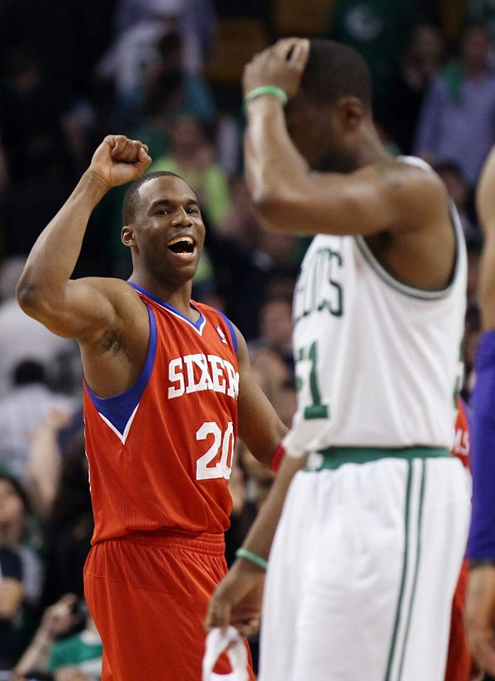 BOSTON, MA - MAY 14:  Jodie Meeks #20 of the Philadelphia 76ers celebrates the win as Keyon Dooling #51 of the Boston Celtics walks off the court after Game Two of the Eastern Conference Semifinals in the 2012 NBA Playoffs on May 14, 2012 at TD Garden in Boston, Massachusetts. The Philadelphia 76ers defeated the Boston Celtics 82-81. NOTE TO USER: User expressly acknowledges and agrees that, by downloading and or using this photograph, User is consenting to the terms and conditions of the Getty Images License Agreement.  (Photo by Elsa/Getty Images)