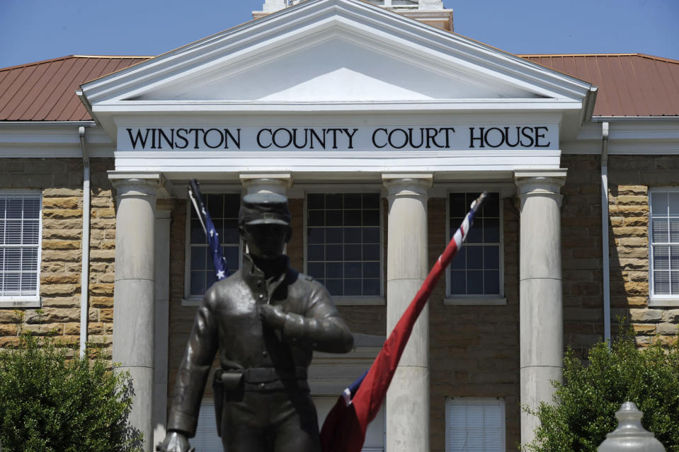 A Civil War monument dedicated to both Union and Confederate soldiers stands outside the Winston County Courthouse in Double Springs, Ala., Monday, April 5, 2021. The county, which attempted to secede from slaveholding Alabama during the war, is trailing the state in COVID-19 vaccinations. Many are hesitant to get shots in the nearly all-white county, and officials say vaccine supply also is a problem. (AP Photo/Jay Reeves)