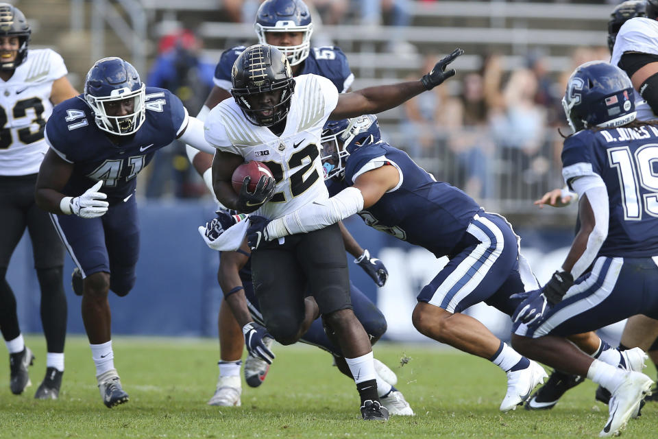 Connecticut defensive back Alfred Chea (22) is tackled by Purdue linebacker Jalen Graham (6) during the first half of an NCAA football game on Saturday, Sept. 11, 2021, in East Hartford, Conn. (AP Photo/Stew Milne)