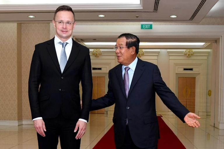 Cambodian Prime Minister Hun Sen (right), picuted with Hungarian foreign minister Peter Szijjarto