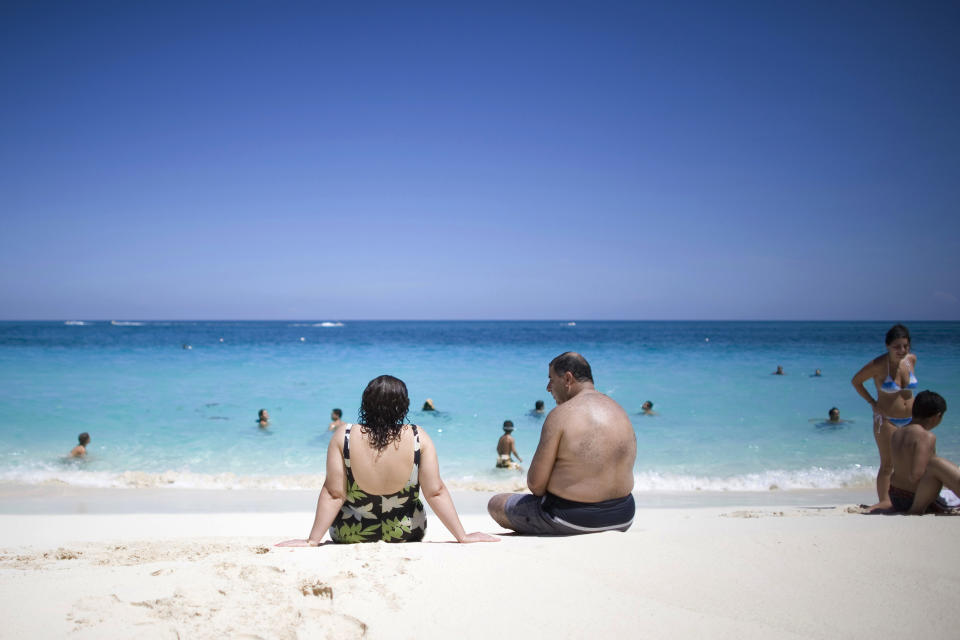 Tourists sunbathe along the beach in Nassau, Bahamas, Saturday, Sept. 6, 2008. (AP Photo/Alexandre Meneghini)