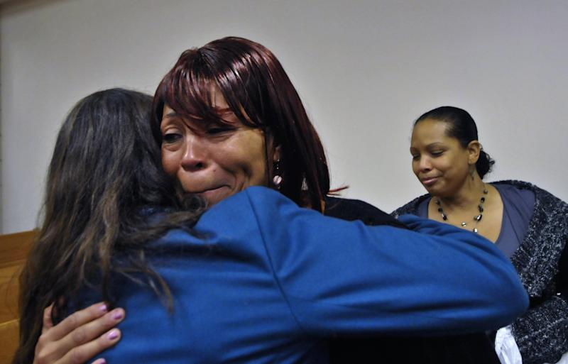 """Towana Choate, center, mother of Quintel M. Augustine cries after Cumberland County Superior Court Judge Gregory A. Weeks commuted the sentences to life without parole under the terms of the state's Racial Justice Act for her son Quintel M. Augustine, Christina S. """"Queen"""" Walters, and Tilmon Golphin, Thursday, Dec. 13, 2012 in Fayetteville, N.C. (AP Photo/The Fayetteville Observer, Raul R. Rubiera) MANDATORY CREDIT"""