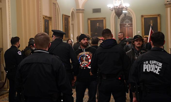 Lawmakers say rioters failed in their attempts to disrupt democracy.