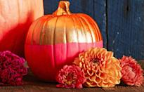 """<p>Play with neon hues and metallics for a two-tone pumpkin that makes a bright statement. Brush or dip one half and let dry. Then tape off and color the other half.</p><p><a class=""""link rapid-noclick-resp"""" href=""""https://www.amazon.com/Jacquard-Lumiere-Metallic-Acrylic-Ounces-True/dp/B001DKJES0?tag=syn-yahoo-20&ascsubtag=%5Bartid%7C10055.g.1714%5Bsrc%7Cyahoo-us"""" rel=""""nofollow noopener"""" target=""""_blank"""" data-ylk=""""slk:SHOP PAINT"""">SHOP PAINT</a><br></p>"""