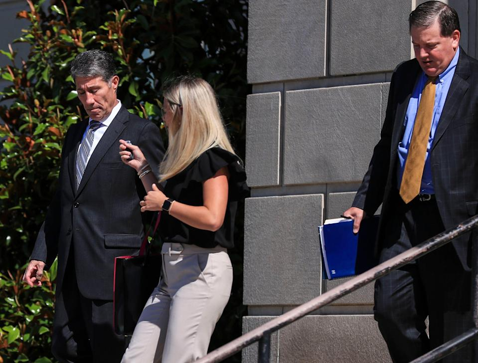 Former assistant coach Dino Gaudio, walking down the steps of the Gene Snyder Federal Courthouse on Broadway in Louisville with a law associate, entered a guilty plea to his UofL extortion case. His sentencing is Aug. 27. At far right is attorney Brian Butler.  June 4, 2021