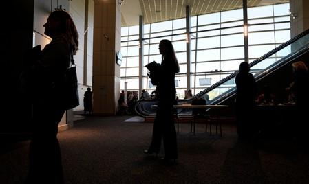 FILE PHOTO: Job seekers wait to talk to recruiters at the Colorado Hospital Association job fair in Denver