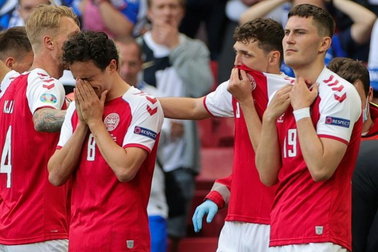 Denmark players were distraught as Christian Eriksen was revived by medics after collapsing
