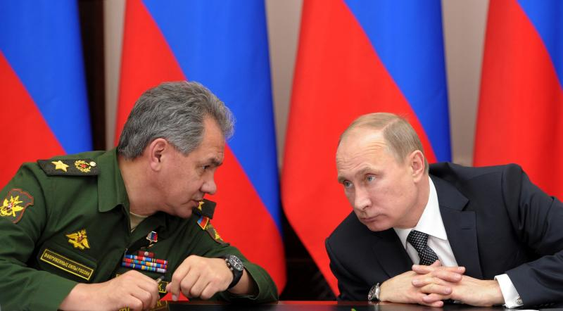 FILE - In this Friday, Nov. 15, 2013 file photo Russian President Vladimir Putin, right, and Defense Minister Sergei Shoigu attend a meeting while visiting the airborne troops school in the city of Ryazan, some 100 km (62.5 miles) southeast of Moscow, Russia. President Vladimir Putin on Wednesday, Feb. 26, 2014, ordered massive exercises involving most of its military units in western Russia amid tensions in Ukraine. (AP Photo/RIA-Novosti, Alexei Nikolsky, Presidential Press Service, File)