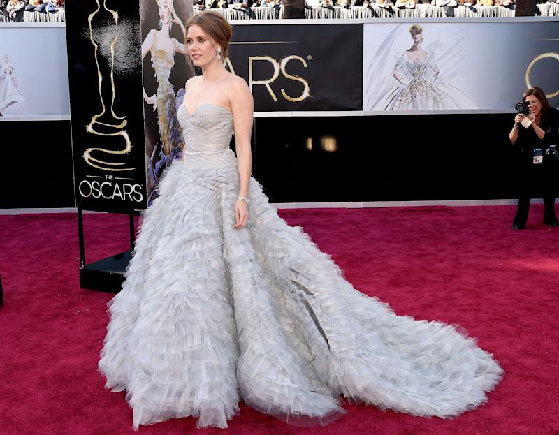 Oscar De La Renta likes to create fantasy and drama in his dresses and this gown worn by Amy Adams is what dreams are made of. More is more, and is definitely more.