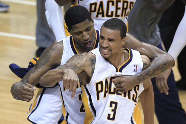 Indiana Pacers' George Hill (3) receives congratulations from Paul George after Hill hit a 3-point shot during the second half of the second game of an NBA first-round playoff basketball series against the Orlando Magic, Monday, April 30, 2012, in Indianapolis. (AP Photo/Darron Cummings)
