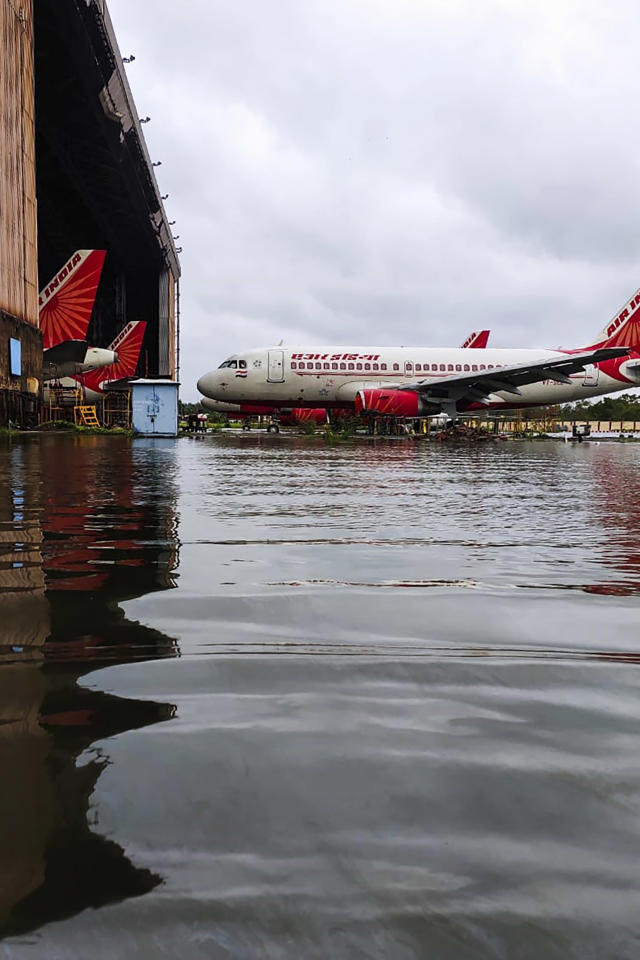 Air India aircrafts are parked at the flooded Netaji Subhas Chandra Bose International Airport after the landfall of cyclone Amphan in Kolkata on May 21, 2020. - The most powerful cyclone to hit Bangladesh and eastern India in more than 20 years tore down homes, carried cars down flooded streets and claimed the lives of more than a dozen people. (Photo by - / AFP) (Photo by -/AFP via Getty Images)