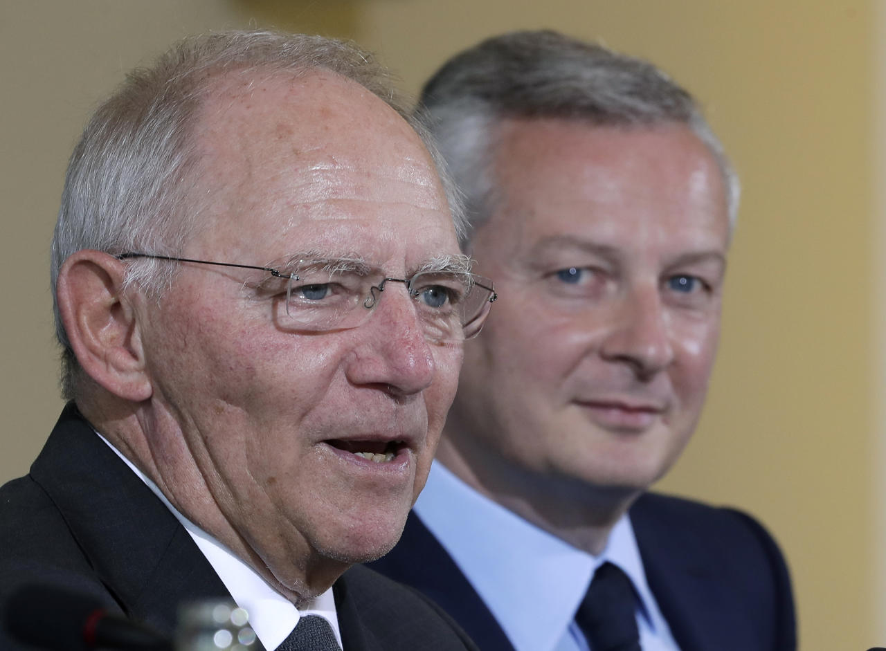 <p> German Finance Minister Wolfgang Schaeuble, left, and Bruno Le Maire, right, Economy minister of France address the media during a joint press conference after a meeting in Berlin, Germany, Monday, May 22, 2017. (AP Photo/Michael Sohn) </p>