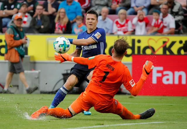 Soccer Football - Bundesliga - FC Cologne v Schalke 04 - RheinEnergieStadion, Cologne, Germany - April 22, 2018 Cologne's Timo Horn attempts to save a shot from Schalke's Yevhen Konoplyanka REUTERS/Wolfgang Rattay DFL RULES TO LIMIT THE ONLINE USAGE DURING MATCH TIME TO 15 PICTURES PER GAME. IMAGE SEQUENCES TO SIMULATE VIDEO IS NOT ALLOWED AT ANY TIME. FOR FURTHER QUERIES PLEASE CONTACT DFL DIRECTLY AT + 49 69 650050 TPX IMAGES OF THE DAY
