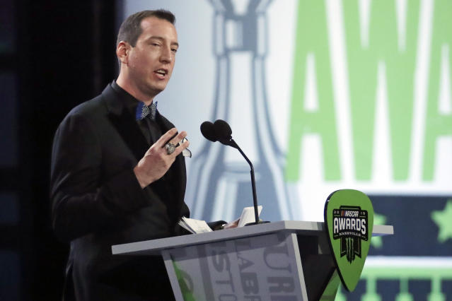 FILE - In this Dec. 5, 2019, file photo, Kyle Busch speaks as he is honored at the NASCAR Cup Series Awards in Nashville, Tenn. Two months removed from that second title, Busch is confident _ adamant almost _ that he will close his career at minimum tied with greats Richard Petty, Dale Earnhardt and Jimmie Johnson. (AP Photo/Mark Humphrey, File)