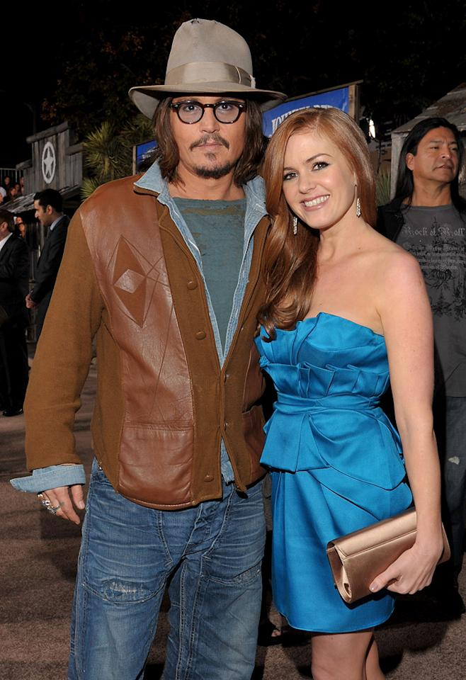 """<a href=""""http://movies.yahoo.com/movie/contributor/1800019485"""">Johnny Depp</a> and <a href=""""http://movies.yahoo.com/movie/contributor/1807879068"""">Isla Fisher</a> attend the Los Angeles premiere of <a href=""""http://movies.yahoo.com/movie/1810079248/info"""">Rango</a> on February 14, 2011."""