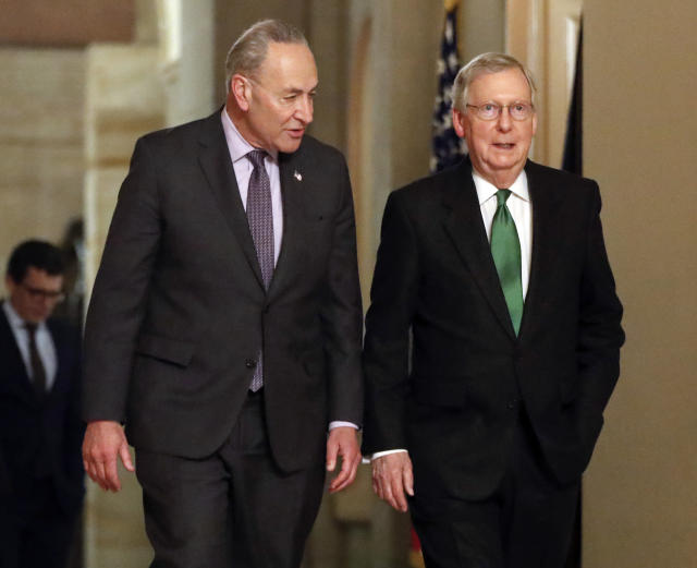 Senate Majority Leader Mitch McConnell, R-Ky., and Senate Minority Leader Chuck Schumer, D-N.Y., left, walk to the chamber after collaborating on an agreement in the Senate on a two-year, almost $400 billion budget deal. (Photo: Pablo Martinez Monsivais/AP)