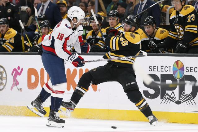 Washington Capitals' Chandler Stephenson (18) checks Boston Bruins' David Krejci (46) during the second period of an NHL hockey game in Boston, Saturday, Nov. 16, 2019. (AP Photo/Michael Dwyer)