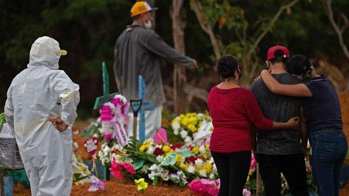 Relatives attend a Covid-19 victim's burial at the Nossa Senhora Aparecida cemetery in Manaus, Brazil on 15 April