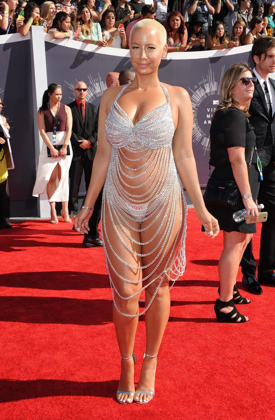 <p>Another VMA's dress, another outfit leaving little to the imagination. Amber Rose showed some skin with a bright and stringy outfit that rivals that of Rose McGowan's in 1998.</p>