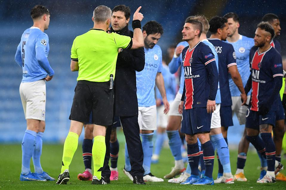 <p>PSG manager Mauricio Pochettino and Marco Verratti spoke to referee Bjorn Kuipers at full-time</p> (AFP via Getty Images)